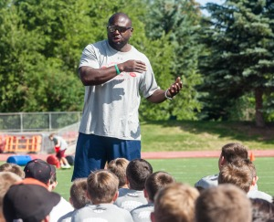 Tony Alford speaks with the youth campers at the G.O.A.T. football camp at Dozier Field. Christopher Reeves/Park Record